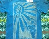 SIZE SMALL - Raised Fist, La Mano Loteria Print, Unisex Light Blue Shirt
