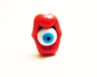 Mouth and eye blue lapel pin