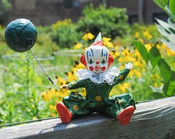 Circus Clown Figurine Holding a Balloon