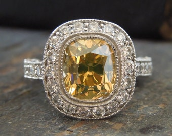 2.14 ct Fancy Yellow Old Mine Cut Diamond in Platinum Mount with Halo