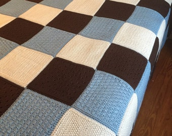 Hand knitted queen size throw