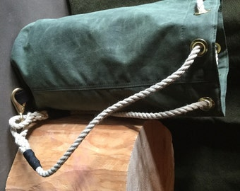 Waxed canvas Ditty Bag in olive with black/tan wool lining. Waxed canvas handbag or crossbody bag.
