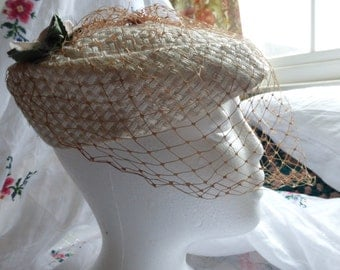 Vintage 1920s/30s straw hat with a veil netting and faded roses