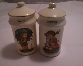"Vintage White Ceramic Little Boy and Girl "" Hummel style"" Salt  and Pepper shaker by J.S.N.Y"
