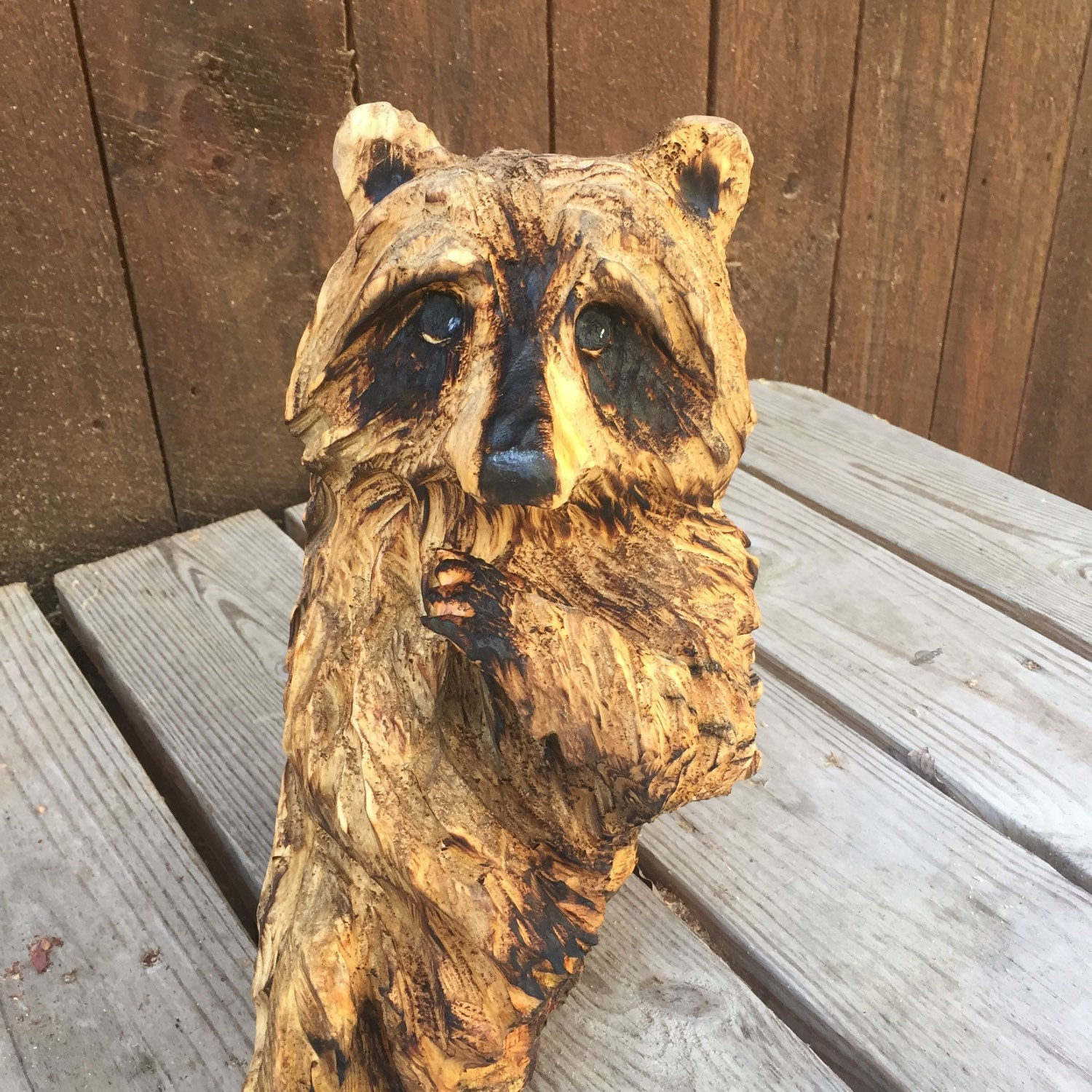 Raccoon chainsaw carving wood carved sculpture