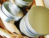 Refillable, Eco- Friendly Tins for Solid Shampoo.