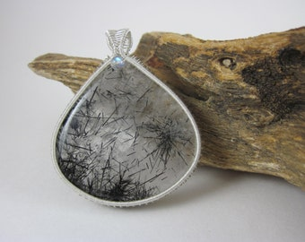 Black Tourmalinated Quartz in Sterling Silver wire frame.