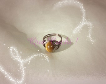 Brown aluminum ring with a pearl Tiger Eye