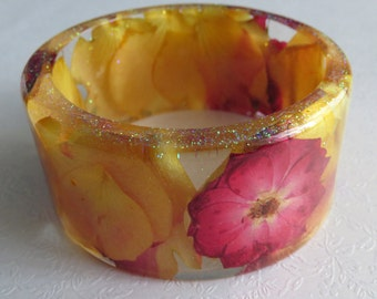 Pressed Flower Resin Bracelet. Yellow And Red Roses, With Micro Fine Glitter.