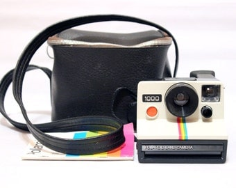 Polaroid 1000 Land Camera + Original Polaroid Bag + Original book instruction