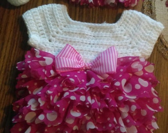 Hot pink and white ruffles on a onsie with hat and booties