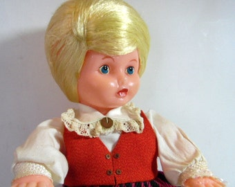 "Vintage plastic, blonde hair doll with blue""  No shoes, slight paint loss to lips. yes, and original clothing. 10"