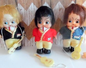 Set of three, vintage pudgy dolls in original package.