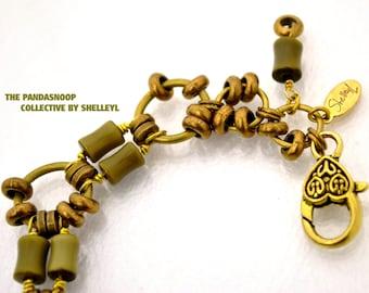 Green Eyes vintage bracelet. Brass with Cats eye glass tube beads bracelet by ShelleyL