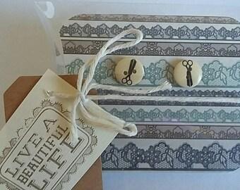 Button scissor earrings in gift box.