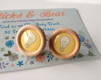 Light Bulb Earrings - 1x pair of quirky wooden earrings in light bulb design - 20mm wood disc set on surgical steel posts - Bright Idea