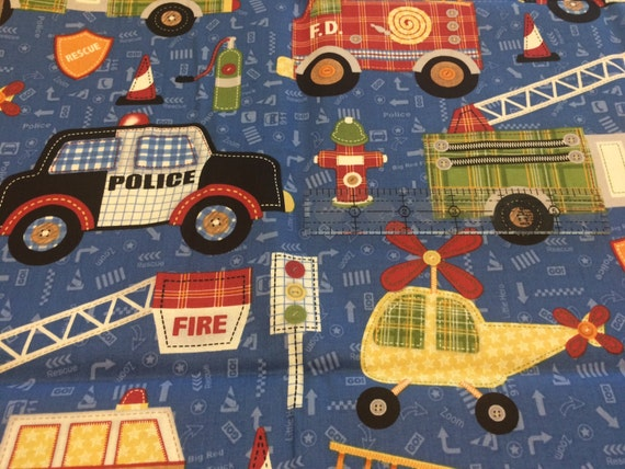 Rescue 911 emergency vehicle fabric by northcott blue fire for Little blue truck fabric