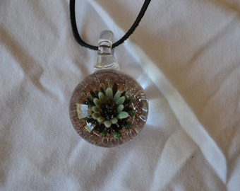 Glass implosion floral pendant