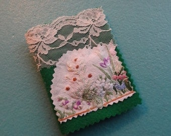 Handmade needle case decorated with vintage materials and with a small lavender sachet on the front.  Ideal gift!