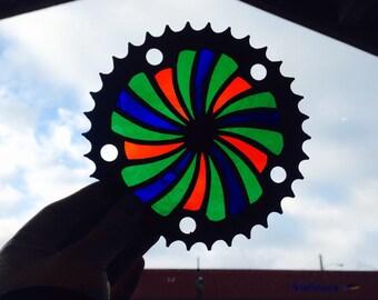Recycled bike part art, spiral suncatcher