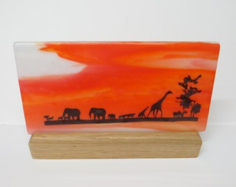African silhouette glass panel in stand