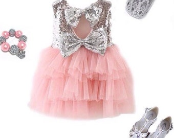 Toddler and girls sparkle dress with layers of pink tulle skirt.Classic round necklince and Glorious detail in back with the double bow.