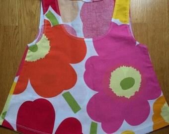 Marimekko Pieni Unikko dress for a little girl, from Finland