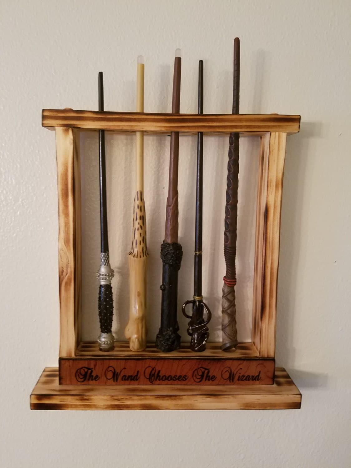 harry potter wand chooses the wizard holds 5 wands wall. Black Bedroom Furniture Sets. Home Design Ideas