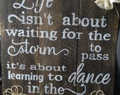 Life isnt about waiting for the storm to pass.. Reclaimed wood sign