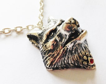 Silver Plated Wolf Pendant With Ruby Red Swarovski Crystal