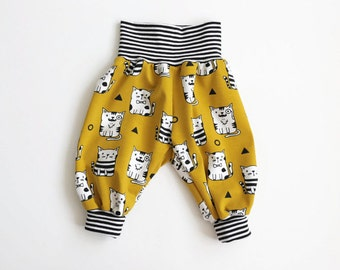 Yellow bubble pants with cute cats. Comfy slouchy infant pants with striped fold over waistband and cuffs. Baby harem pants.
