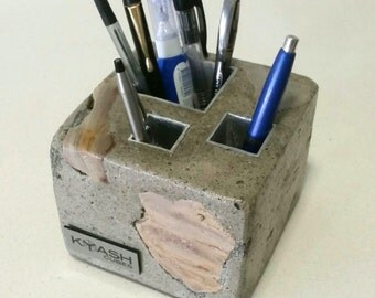 Concrete pen holder - cube shape exposed stone with a grey polished concrete finish