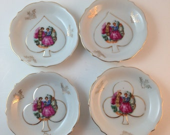 Four Vintage China  Betson Handpainted 4 inch decorative plates