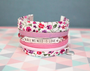 """Cuff leather bracelet and liberty pink """"All you need is love""""."""
