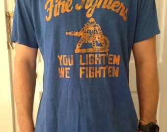 You light em, We Fight em - Vintage Firefighter T-Shirt