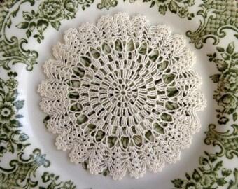 Cream round crocheted doily No.20