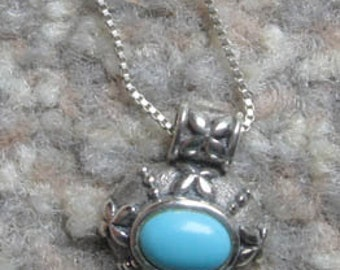 Sterling silver necklace with turquoise stone tribal