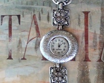 Chicos 1990s Watch  Gothic Design  Cuff Bracelet Link Panels  Light Aluminum and Magnetic clasp  Very  Nice and Working  Condition  Quartz