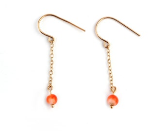 A Pair of 9ct Gold and Natural Coral Earrings