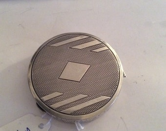 Unusual silver compact, with a section inside which has two rotating blades.