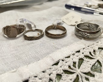 Choice of four vintage silver rings