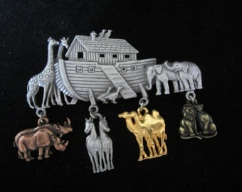 Noah's Ark Pewter Brooch By The Jonette Jewelry Co. Mid 80's. Has four animal charms. Craftsmanship & detail of ark and charms is amazing!