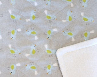 Baby blanket (medium weight) for bassinet and pram: Bird flannelette and eco friendly bamboo fleece with quilted leaf design