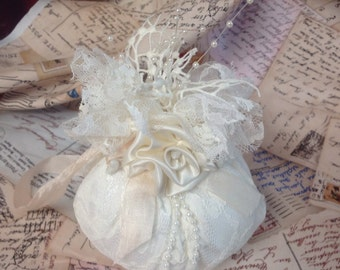 "Satin and lace hanging sachet . Scent is ocean breeze. 4 1/4"" wide, 5"" high. Approx."