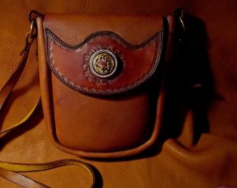 "Custom leather cross shoulder bag with 1-1/4"" western medallion."