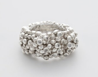 Unique silver ring with a dash of clear diamonds, finishing touch to any occasion or outfit