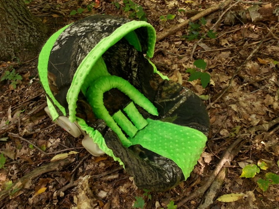 camo infant car seat cover made with mossy oak fabric and lime