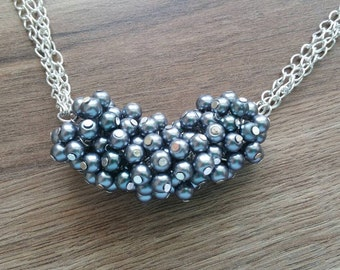 Pearl cluster necklace.