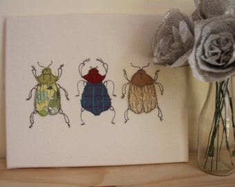 Fabric art, applique, original handmade textile art, three beetles, display of insects