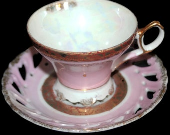 Vintage Pink,White,and Gold Teacup and Saucer